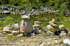 The Monument  Someone lost a person dear to them.  There under & in the shade of the big stone are two unopened cans of beer.  The brands escape me.  Found along the East Fork Of The South Fork of the Salmon River in Idaho, State.  Somehow I found this touching !