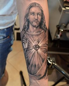 What does jesus tattoo mean? We have jesus tattoo ideas, designs, symbolism and we explain the meaning behind the tattoo. Jesus Forearm Tattoo, Forearm Tattoos, Body Art Tattoos, Sleeve Tattoos, Jesus Tattoo Sleeve, Rib Tattoos, Tattoo Arm, Flower Tattoos, Jesus Tattoo Design