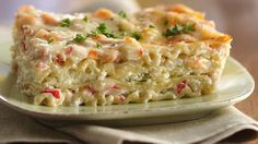 A luscious white sauce partners with mild-flavored imitation crabmeat and shrimp in a comforting lasagna.