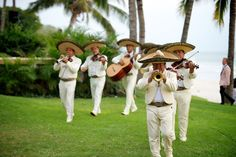 Following the oceanfront nuptials of Courtney Mazza and Mario Lopez, the sounds of lively mariachi music filled the air as guests headed to the reception area. Photography: Kevin Weinstein Photography. Read More: http://www.insideweddings.com/weddings/courtney-mazza-and-mario-lopez/440/