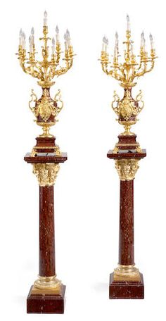 An imposing pair of Louis XVI style gilt bronze mounted rouge marble nine light candelabra on matched pedestals <BR />late 19th century