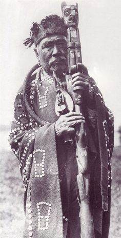 Image result for historical kwakiutl man with totem pole
