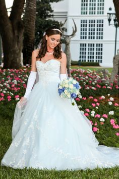 This bride looks absolutely stunning in her limited edition Cinderella Diamond Collection ball gown. #blue #dress #wedding
