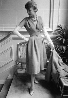 """Claire in Dior's ensemble called """"Gai Paris"""", Autumn/Winter Collection Vivante Line, 1953, photo by Mark Shaw at Maison Dior, Paris."""