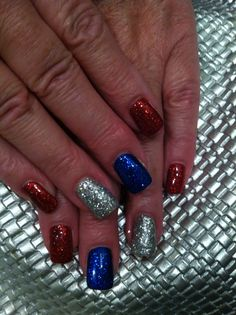 I applied silver, red and blue gel polish on my sisters nails then pressed in loose glitter. Go red white and blue