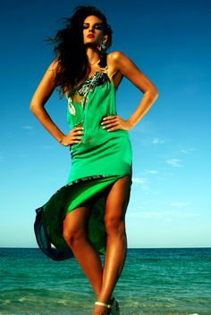 Switch from beach to bar in this luxurious one shoulder silk maxi dress. Caffe Swimwear
