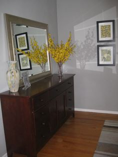 yellow grey bedroom. yellow branches, framed fabric swatches.