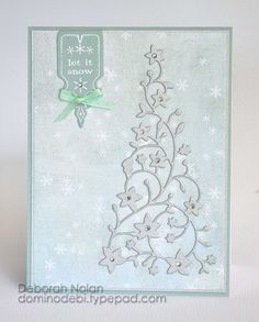 """Memory Box Thistle card stock, Silver Soiree Cardstock, patterned paper; Flowering xmas Tree die, Chadwick Label (98209), Let it Snow Label (B1779), MB diamond stickers, silver emboss pdr, Offray ribbon        1.4.25"""" x 5.5"""" card from MB Thistle card stock.   2.Cut Silver Soiree Shimmer paper and patterned paper mats in nesting sizes,adhere to @ other.   3.Stamp/emboss Let It Snow Label  over pattern& shimmer paper set above before adhering mat to card"""