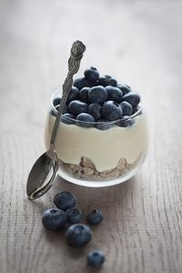 Yoghurt with fresh blueberries and some cereal, I think..