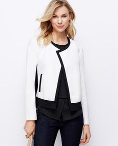 """Defined with striking contrast trim, this moto-styled jacket revs up in high impact hues and rich texture. Open front. Long sleeves. Vertical welt pockets. Lined. 22"""" long."""