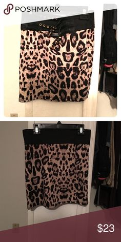 Skirt Cheetah print skirt with a belt attached to it. Goes good with a black top. In perfect condition (EUC) Skirts Midi