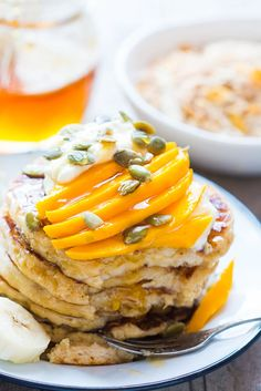 Get the recipe for the fluffiest gluten free oatmeal cottage cheese pancakes and you won't be able to tell that they are also eggless! Topped with mango yogurt and mixed nuts. A fantastic recipe if you focused on clean eating, no preservatives or artificial flavors! Vegetarian and Gluten Free too