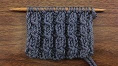 This video knitting tutorial will help you learn how to knit the left twist stitch. This mock cable stitch allows you to create twists in your knitting over two stitches without a cable needle.