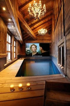 1) Its a Home theater with indoor pool and 2) what gorgeous wood ceilings, walls, floors...  beautiful!