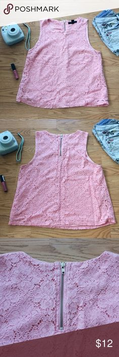 F21 Pink Lace Tank Top ▪️Product Description▪️ ▫️Pretty in pink with this adorable lace tank top that is perfect for any occasion ▫️The lining keeps the inside comfortable and silky for warmer days ▫️The zipper adds a metallic touch to the back  ▪️Fit: True to size  ▪️Condition: Excellent used condition  ▪️Measurements: Approx/Laying Flat  ▫️Length- 21 inches  ▫️Bust- 17 inches ▫️Waist- 16.5 inches  ▫️Strap- 2.25 inches Forever 21 Tops Tank Tops