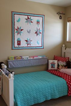 aqua bed spread with red accents....probably not polka dots though...too mini mouse little girly...we need something a little more sophisticated :)