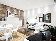 Salón con pared piedra y pintura