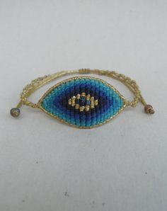 Evil eye beaded macrame braceletAdjustableAll by LuckyRatJewellery