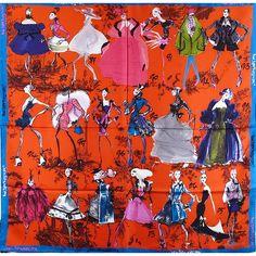 Christian Lacroix - Foulard 20 ans rouge -  Foulard original confectionné par Christian Lacroix.   Foulard sur le thème de la mode, représentant des figurines.   Matière: soie.   Couleur: rouge.   Dimensions du foulard: 90x90 cm.