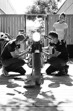 Saturday morning tattooed mates working on bike #CafeRacer #TonUp