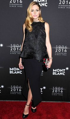 Olivia Palermo in a shiny black top and high-slit skirt