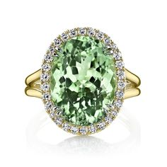 Mint Green Tourmaline Halo Ring Green tourmaline and diamond ring handcrafted with an 8.64 carat oval green tourmaline center stone accented by 0.40 carats of brilliant diamond rounds set in 18K yellow gold.