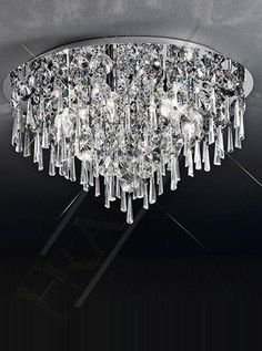The Jazzy Large Ceiling Light by Franklite Lighting is available from Luxury Lighting. The Franklite Jazzy Ceiling Light has a variety of crystal glass drops graduating from the centre of the light.