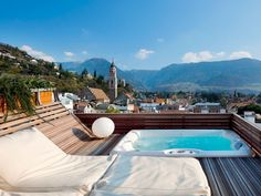 This design hotel sits in South Tyrol, about four hours northeast of Milan and has just 12 rooms, each decorated and designed by a local artist. The all-white upstairs loft has access to the pictured whirlpool overlooking the town of Merano. Not your style? Pick from the '70s-inspired, red-walled Imperial room or the Artroom Galaxy space that includes a celestial ceiling mural.