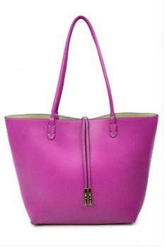 """Magenta/Taupe 3-in-1 reversible tote is stylish and functional. The interior pouch is fully lined and includes zippered compartments as well as additional zip and slip pockets for security. A detachable adjustable strap is included to convert the pouch into a crossbody to wear on its own. 11""""High, 16.6"""" Deep, 10"""" strap drop Departure Tote  by Remi & Reid. Bags - Totes Texas"""