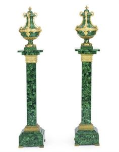 A PAIR OF GILT-BRONZE MOUNTED MALACHITE COVERED URNS-ON-PEDESTALS,  20TH CENTURY  The urns 21in. (53cm.) high; the pedestals 43½in. (110.5cm.) high (2)