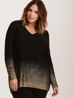 """A sweater that starts the party! This black knit pullover style prioritizes your comfort with a brushed, buttery-soft feel and a tunic fit. But the rest of the details are turned-up, with a gold metallic ombré pattern highlighting the bottom. The cutout back is sexy with strappy detailing.<div><br></div><div><b>Model is 5'9.5"""", size 1<br></b><div><ul><li style=""""list-style-positi..."""