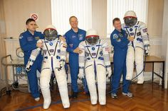 Roscosmos commander Yuri Malenchenko, NASA astronaut Tim Kopra and ESA astronaut Tim Peake stand by the Sokol suits they will wear on launch day, 15 December.  Soyuz astronauts get to try their spacecraft and suits for the first time two weeks before being launched to the International Space Station. Each suit and spacecraft seat is tailor-made for comfort and safety.