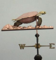 Sea Turtle  Coral Weather Vane by West Coast Weather Vanes.  This custom made handcrafted Sea Turtle weathervane has a copper shell with brass head, flippers and tail. and a copper coral sea floor.