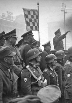 Croatian foreign legionaries of the Wehrmacht along with members of the Ustaše take part in a national rally led by the Poglavnik of Fascist Croatia, Ante Pevelič in Saint Marks square, Zagreb- the capitol of the newly formed independent Croatian state.