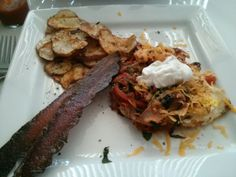 Huevos rancheros, red potato chips and turkey bacon