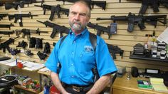 PASADENA, Md. –  Maryland residents have been buying guns in record numbers before a law takes effect Tuesday, with provisions aimed at helping keep guns away from criminals and the mentally ill, strengthening safety training and banning 45 types of assault weapons.Frank Loane, owner of Pasadena Pawn and Gun, stands in front of a wall of assault rifles at his store