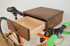 The Clifton Bike Rack - Stylish wall mount indoor bike shelf in walnut with drawer for accessories and bike gear. Rack Velo, Bicycle Storage, Bicycle Rack, Bmx Bicycle, Bicycle Girl, Bike Hanger, Bike Shelf, Bicycle Wheel, Dovetail Drawers
