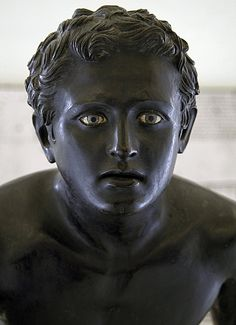 Bronze statue of an athlete. Naples, National Archaeological Museum. Roman copy after Greek original of the 4th century B.C.