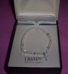 New SWAROVSKI Crystal  Bracelet has Crystal Cross charm fits small-med #Swarovski #Beadedsimulatedpearlswrealcrystalcross