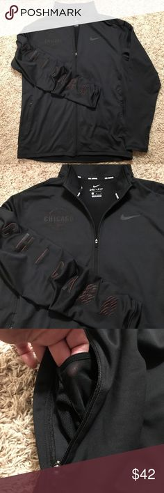 Nike Men's Running Jacket Nike dri-fit jacket with full front zipper, zippered side pockets and interior side pockets with cord loop for media player, Dri-fit fabric to wick sweat away and help keep you dry and comfortable, thumb holes and reflective strips for visibility at night. Back of Jacket reads...Bank of America Chicago Marathon 2016 and CHICAGO down the right arm, lettering is raised, black with red on the sides. Nike Jackets & Coats