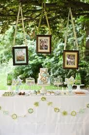 Pretty table set-up for drinks or some desserts. I like the idea of having a couple of framed engagement pictures on the tables.