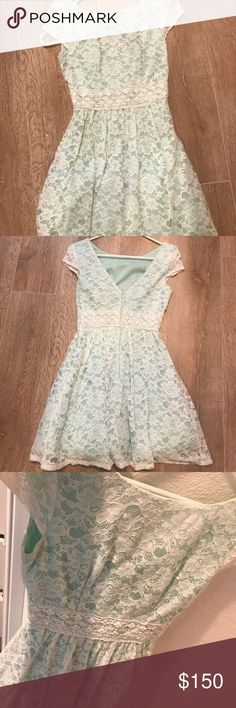 A short white laced- sea foam dress This is a very cute really fun white laced- sea foam underneath dress. It's a size 2, no damages fun to wear at any events.  No damages and it is true to its size! B Darlin Dresses Mini