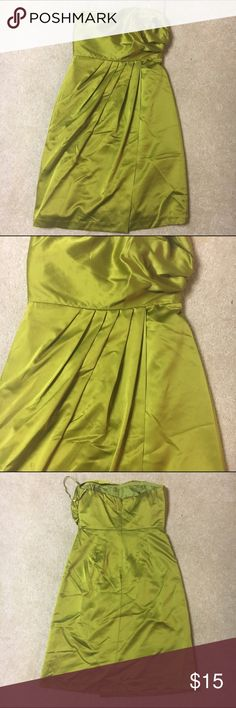 The Limited Green Dress Kind of a pea green color. Back zipper closure with rubber trim around top front of chest area. One side flips over the other. Strapless dress. The tag is somewhat worn and can't make out the size but I believe it is a women's zero. The Limited Dresses Strapless