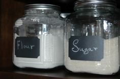 Someone put chalkboard paint on Anchor Hocking glass storage jars. What a great idea!