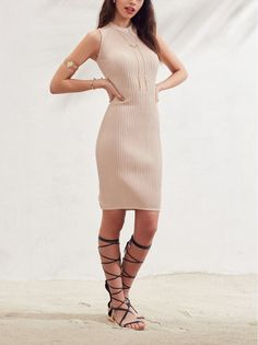 Soft and stretchy ribbing hugs the curves, making this sleeveless body-con dress as striking as it is comfortable, with a flirty cutout flashing a bit of the lower back.