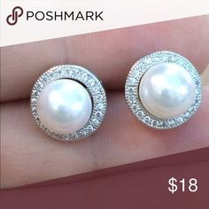Rhodium Plated White Pearl CZ Halo Stud Earrings Rhodium plated round white imitation pearls with a pave set cubic zirconia halo.  Stud earrings feature posts with friction backs and measure 3/8 inch L x 3/8 inch W.  Perfect for a special occasion or dressing up an outfit for work. Jewelry Earrings