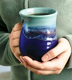 Handwarmer Mug via handcrafthousegallery: Shaped like a mitten, so the heat of your drink can warm up your hands. Made of stoneware pottery. #Mug #Handwarmer