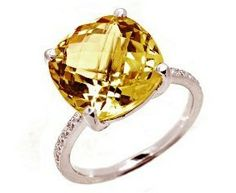 Cushion Cut Yellow Beryl & Diamond Engagement Ring - One of the most unique pieces we've ever reviewed comes this 18k White Gold Cushion Cut Yellow Beryl & Diamond Engagement Ring featuring a stunning Yellow Beryl Cushion Cut center stone along with White Round cut accent stones on both sides of the shank. This Cushion Cut Yellow Beryl engagement ring is a VVS in diamond clarity & the total gem weight is 5.20 carats & the diamonds are 100% natural. #unusualengagementrings