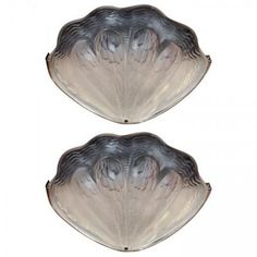 Marvin Alexander,Inc. Art Deco molded glass sconces with shell motif and nickel frames, France, circa 1930