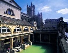 The Roman Baths, Bath, Somerset with Bath Abbey in the background.